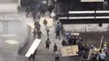 Dos heridos tras pelea entre barristas y evangélicos por toma de explanada [VIDEO]